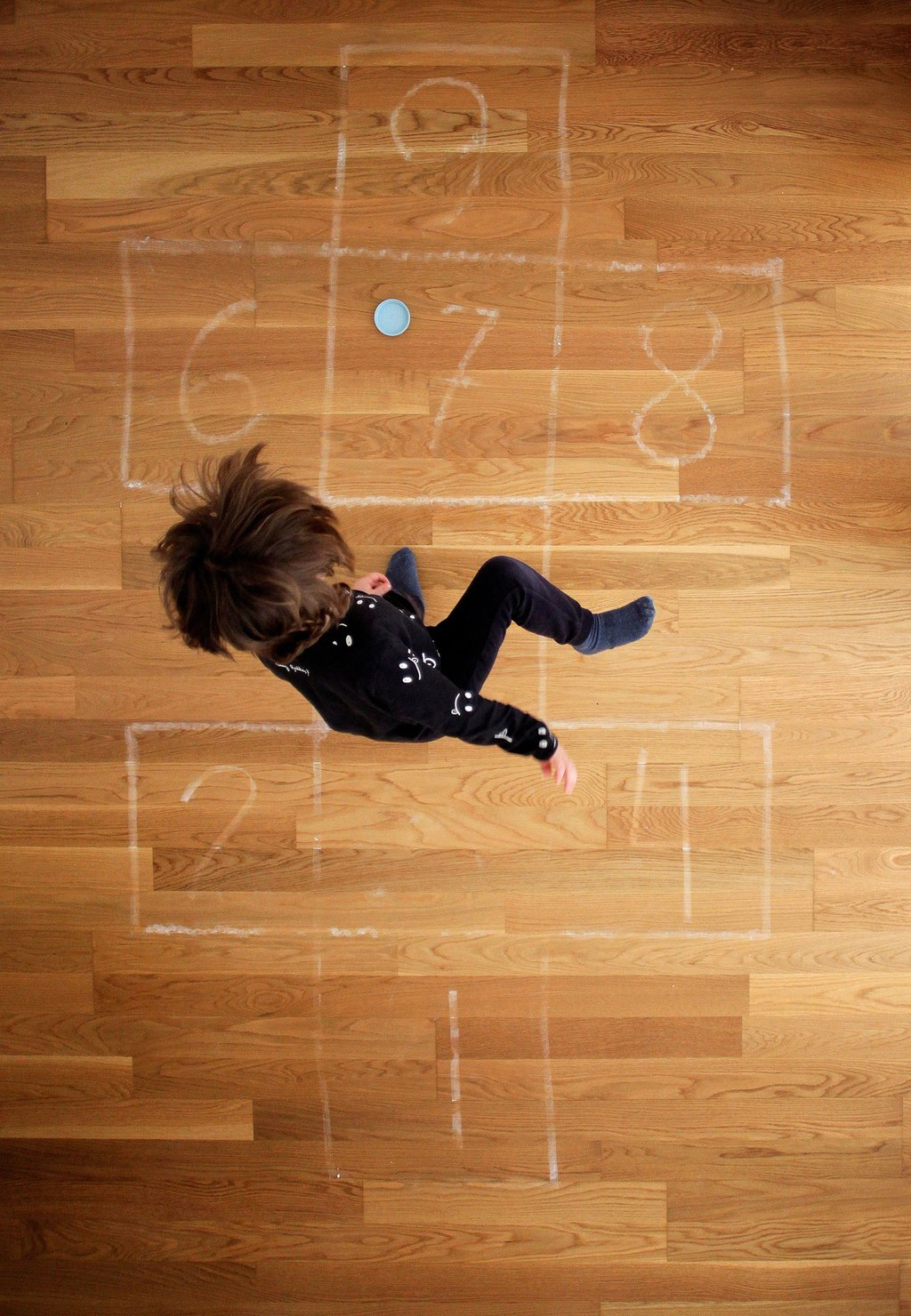 A boy plays hopscotch at his home in A Coruna, Spain, on April 23. Cabalar-EPA-EFE-Shutterstock.jpg