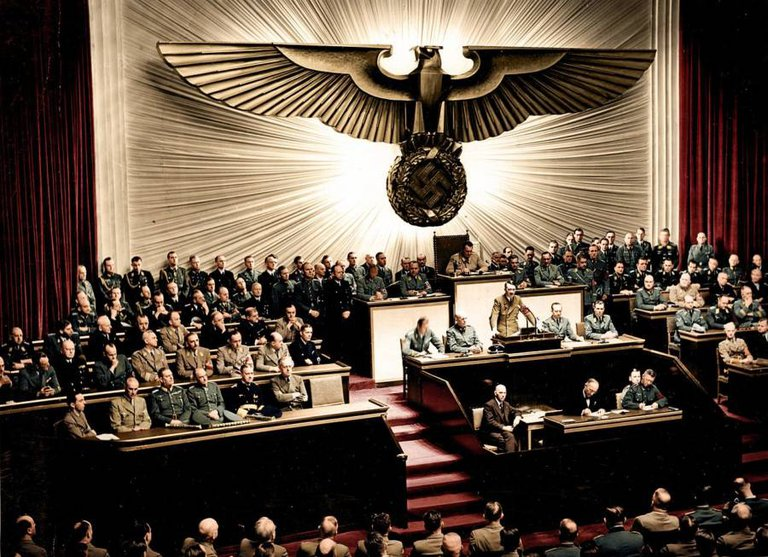 Adolf Hitler (standing, center) declares war on the United States at the Reichstag in Berlin, Germany on December 11, 1941..jpg