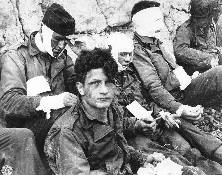 American soldiers, injured while storming Omaha Beach on D-Day, recover just after the landings in Normandy, France on June 6, 1944..jpg