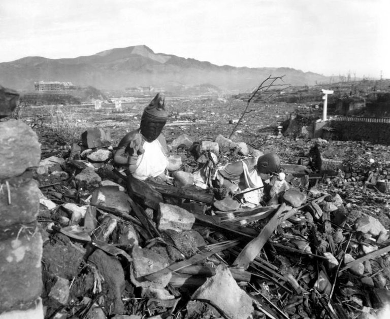 Battered religious figures stand amid the rubble of Nagasaki, Japan on September 24, 1945, six weeks after the U.S. destroyed the city with an atomic bomb..jpg