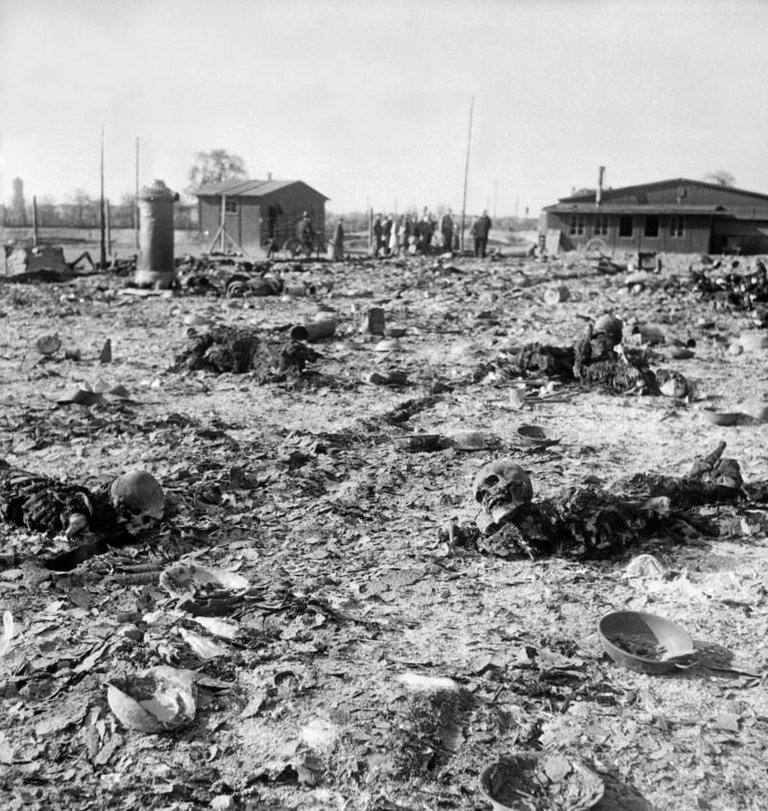 Burnt bodies lie on the grounds of the Thekla concentration subcamp, outside Leipzig, Germany, April 1945..jpg