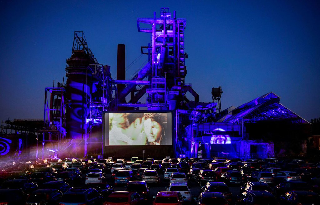 Cars sit at a newly opened drive-in cinema in Dortmund, Germany, on April 17. It's in front of a former blast furnace.Ina Fassbender-AFP-Getty Images.jpg