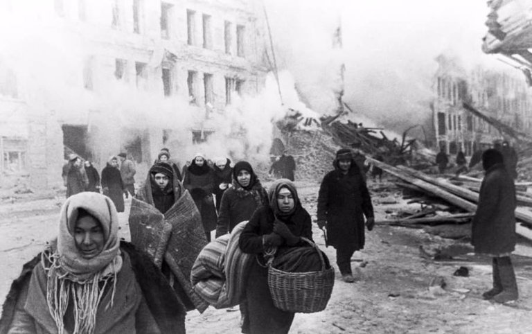 Citizens of Leningrad, Soviet Union vacate their houses, destroyed by German bombing, on December 10, 1942..jpg