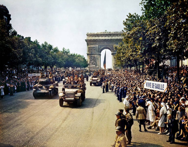 Crowds gather on Paris' Champs Elysees as French tanks roll past in celebration of the liberation of France on August 26, 1944..jpg