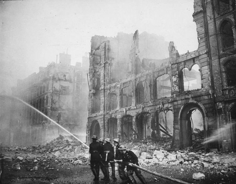 Firefighters put out a blaze caused by a round of German bombings in London, 1941..jpg