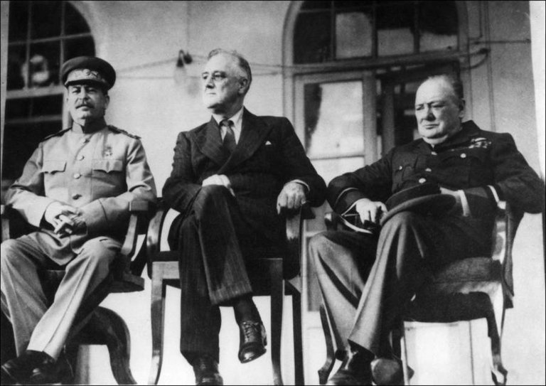From left, Soviet leader Joseph Stalin, U.S. President Franklin D. Roosevelt, and British Prime Minister Winston Churchill meet at the historic Tehran Conference in Iran on November 28, 1943..jpg