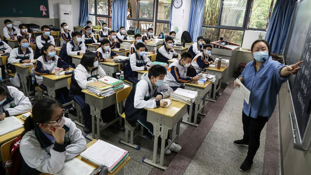 High school students study in a classroom in Wuhan, China, as they returned to school on May 6.STR-AFP via Getty Images.jpg