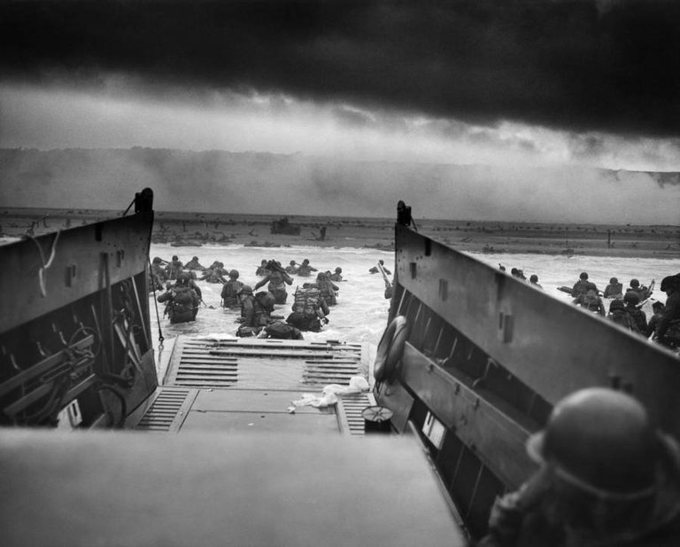 Into the Jaws of Death — U.S. Troops wading through water and Nazi gunfire..jpg