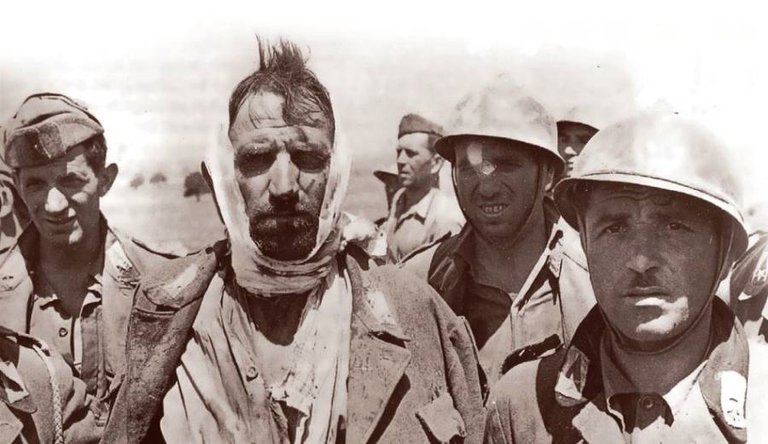 Italian soldiers taken prisoner by British forces after the Allied landing in Sicily, July 1943..jpg