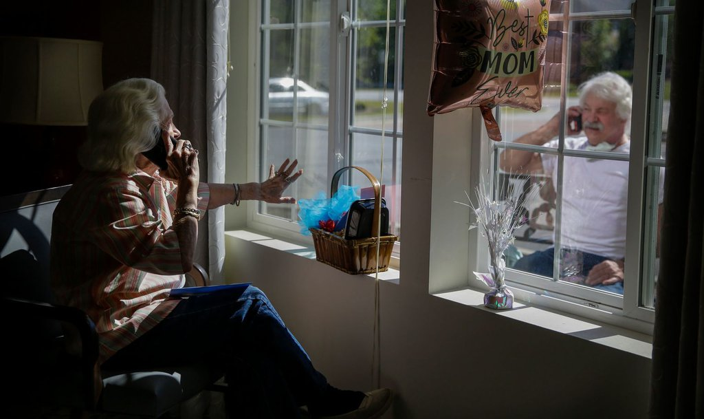 Mary Faye Cochran sings 'You Are My Sunshine' to her son Stacey Smith from her senior-living facility in Smyrna, Georgia, on May 10. It was Mother's Day in the United States.Brynn Anderson-AP.jpg