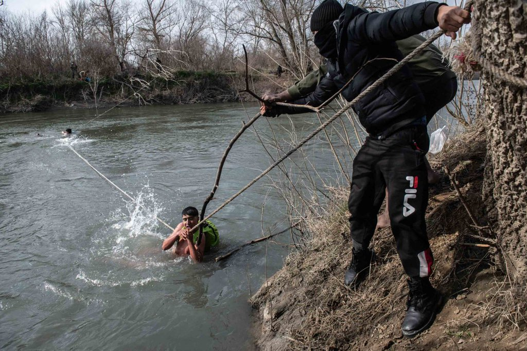 Migrants are rescued from the Evros river after trying to cross from Turkey into Greece on March 1 Burak Kara.jpg