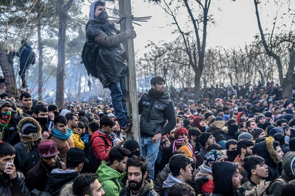 People in Pazarkule gather inside a buffer zone at the border on Saturday, February 29.Bulent Kilic AFP.jpg