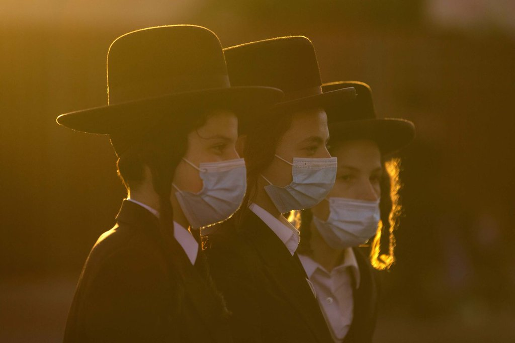 Ultra-Orthodox Jews gather for a July 13 protest over lockdown measures in Jerusalem.Oded Balilty-AP.jpg